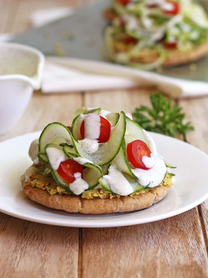 Chickpea Cucumber Mini Pita Pizzas. A light and refreshing summer meal of toasted mini pitas, chickpeas, spiraled veggies and a tangy yogurt sauce.