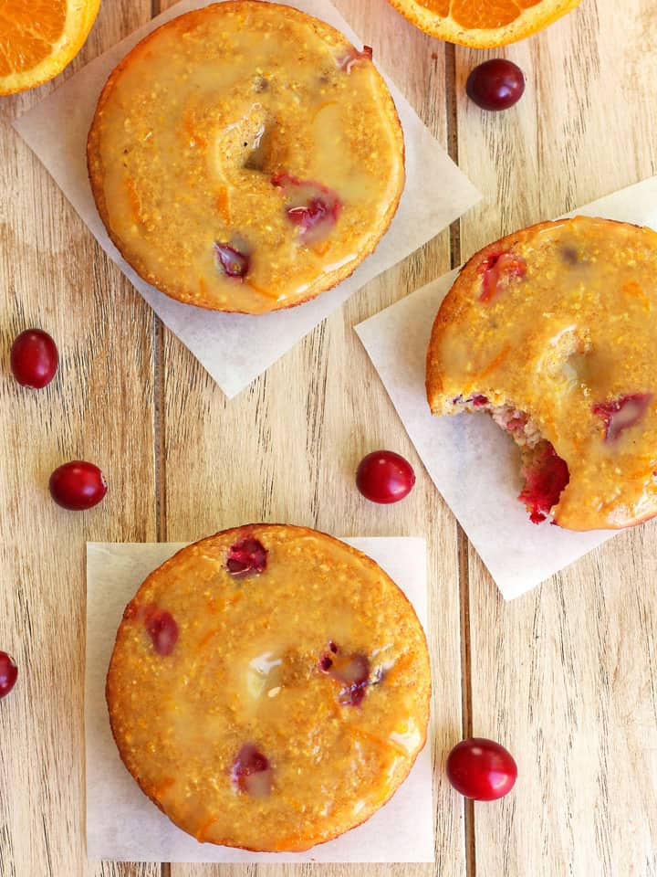 Cranberry Orange Cornbread Donuts. Hearty donuts filled with tart cranberries, tangy buttermilk and toothy cornmeal. Drizzle baked donuts with a honey sweetened orange glaze for a delicious less than 200 calorie treat. Less than 30 minutes and so simple you can make them in your toaster oven!