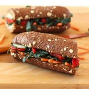 Roasted Red Pepper, Carrot and Hummus Sandwich. A not sad desk lunch bursting with flavor from sweet fire-roasted red peppers, creamy avocado, nutty hummus, bitter kale and crunchy veggies on a crusty loaf of whole grain bread.