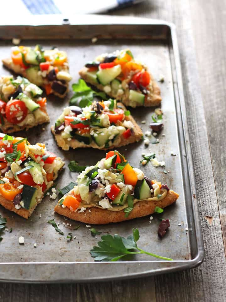 Veggie Hummus Flatbread. Delicious whole wheat naan topped with protein rich hummus and flavorful fresh veggies. A quick and healthy meat-free lunch for two.