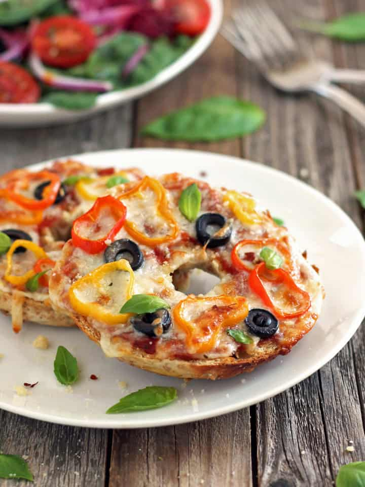 Toaster Oven Pizza Bagels. Just 15 minutes for these crispy chewy cheesy pizza bagels you can easily make in your toaster oven.