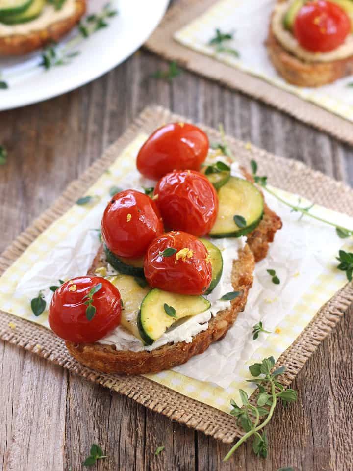 Roasted Zucchini and Tomatoes Crostini are a light dinner for two that highlights the season's best produce. Slice them into smaller pieces for a flavorful appetizer your guests will love!