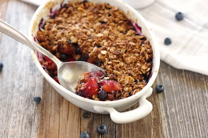 Blueberry Mango Crisp, a small toaster oven dessert bursting with sweet-tart fruity summertime flavor. Don't forget the ice cream!