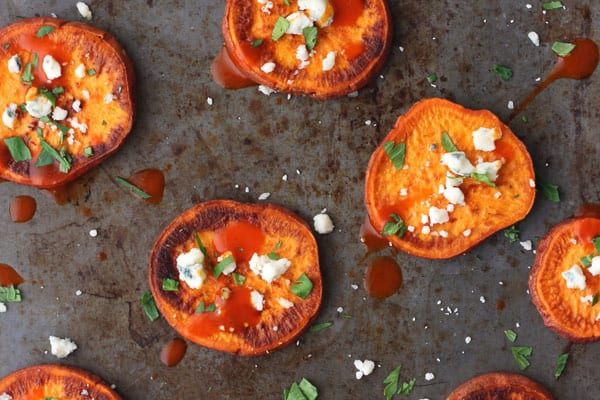 Buffalo Blue Cheese Sweet Potato Slices are rich, tangy and the perfect appetizer for any party or just watching the game on a Sunday afternoon.