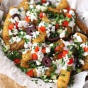 Toaster oven Greek fries are the appetizer to get your party started. The flavorful seasoning and toppings are addictive.