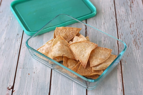 Leftover chips in a glass container.