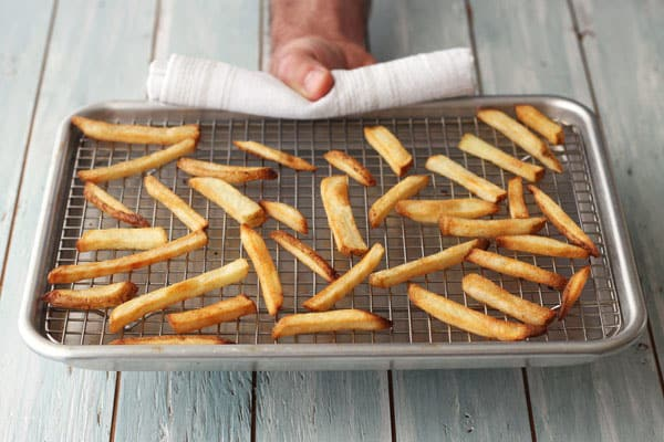 Immediately up your crispy fry game by using a rack to bake your frozen fries in your toaster oven.