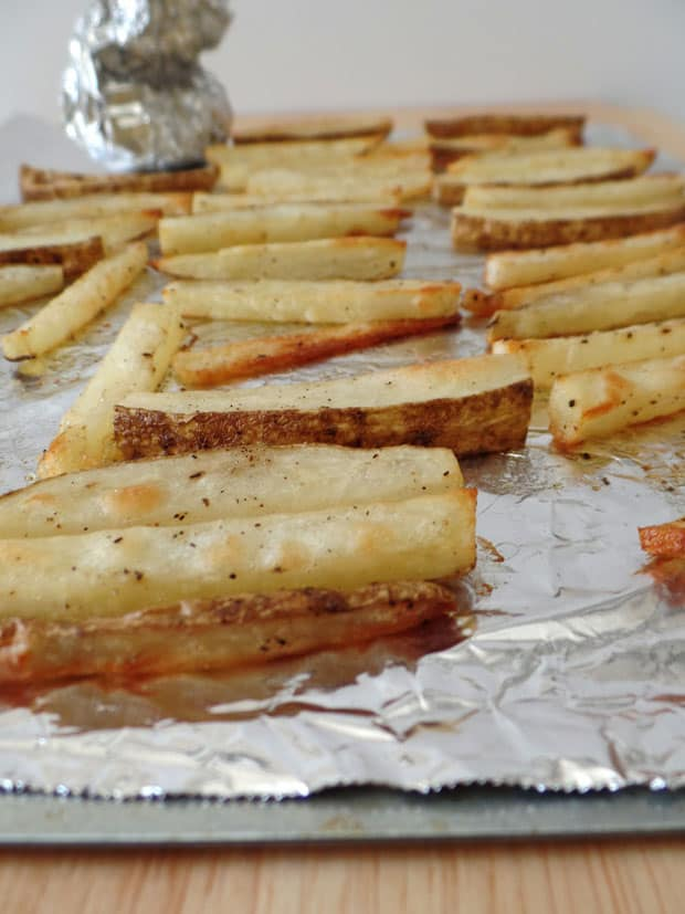 Toaster Oven Garlic Fries. A lightened up recipe for toaster oven baked fries covered in sweet roasted garlic, olive oil and parsley. Just like the ballpark but better for you!