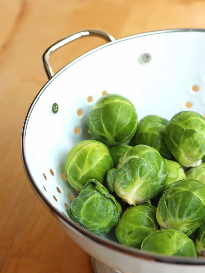 Toaster Oven Roasted Brussels Sprouts, simple step-by-step directions for making deliciously tender yet toothy coconut oil roasted Brussels sprouts.