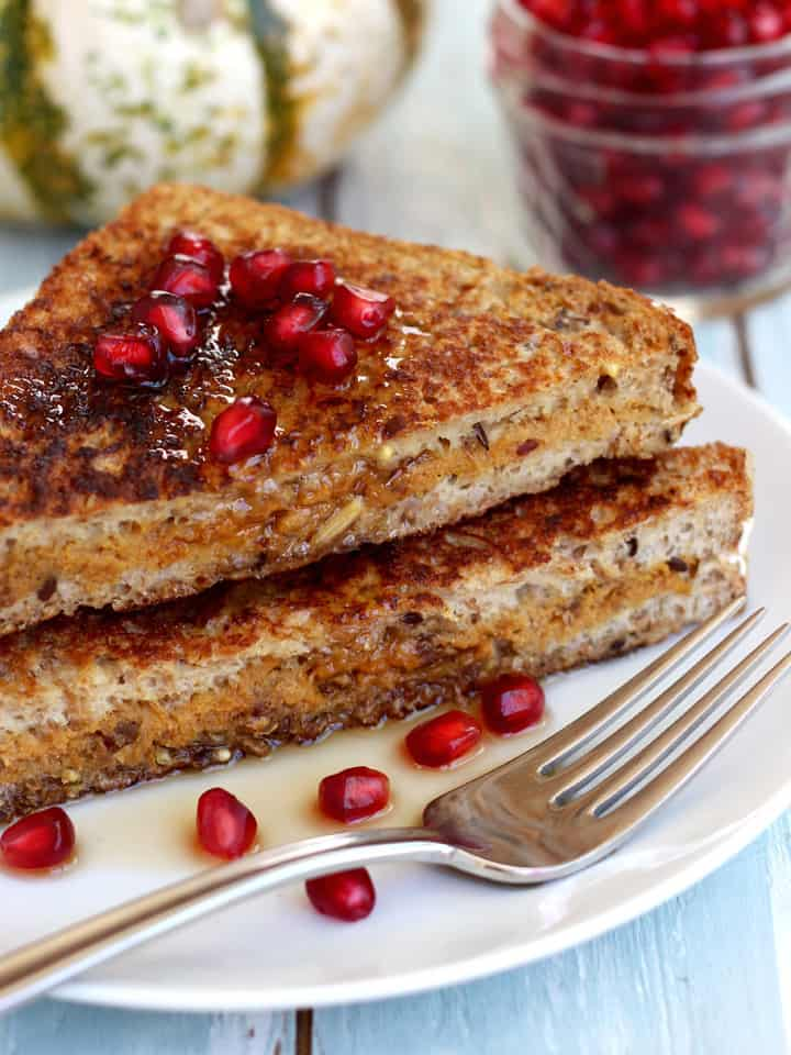 Pumpkin Ricotta Stuffed Maple French Toast. A delicious fall breakfast treat for two. Whole grain bread stuffed with date sweetened pumpkin and ricotta, dipped in a maple custard and fried to perfection.