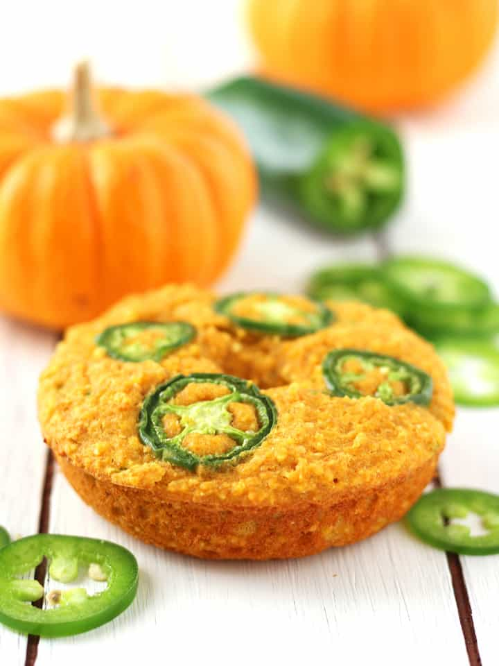 Jalapeño Pumpkin Cornbread Donuts. A moist and spicy cornbread donut perfect as buns for fried egg sandwiches, with vegetarian chili or warmed with butter and honey as a late night snack.