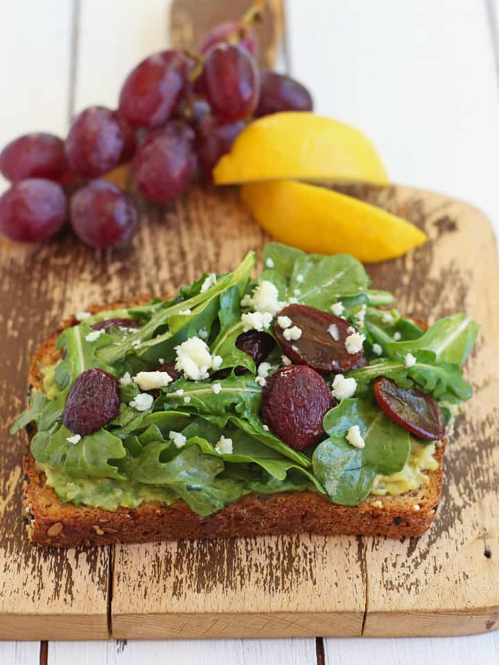 Avocado Toast with Balsamic Roasted Grapes. Whole grain toast, creamy avocado and tangy-sweet balsamic roasted grapes.