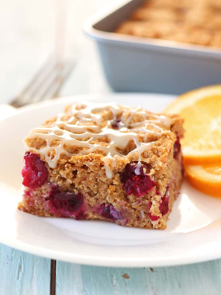 White Chocolate Cranberry Orange Snack Cake. Honey sweetened whole grain snack cake studded with tart fresh cranberries, bright orange flavor and a white chocolate drizzle.