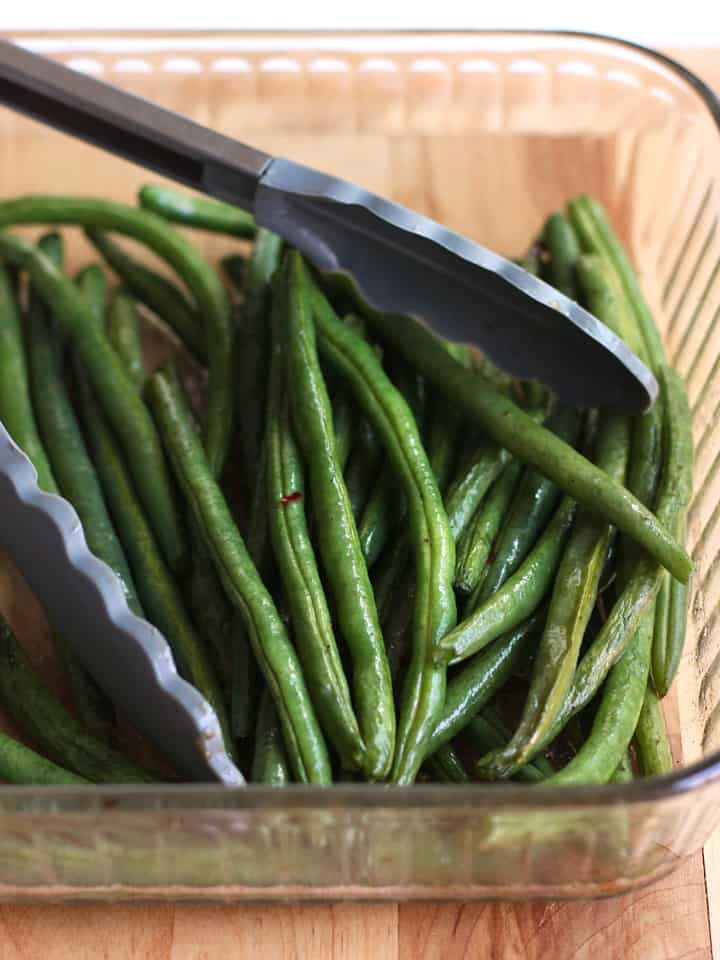 Roasted Green Beans in a pyrex dish that is not safe for your toaster oven.