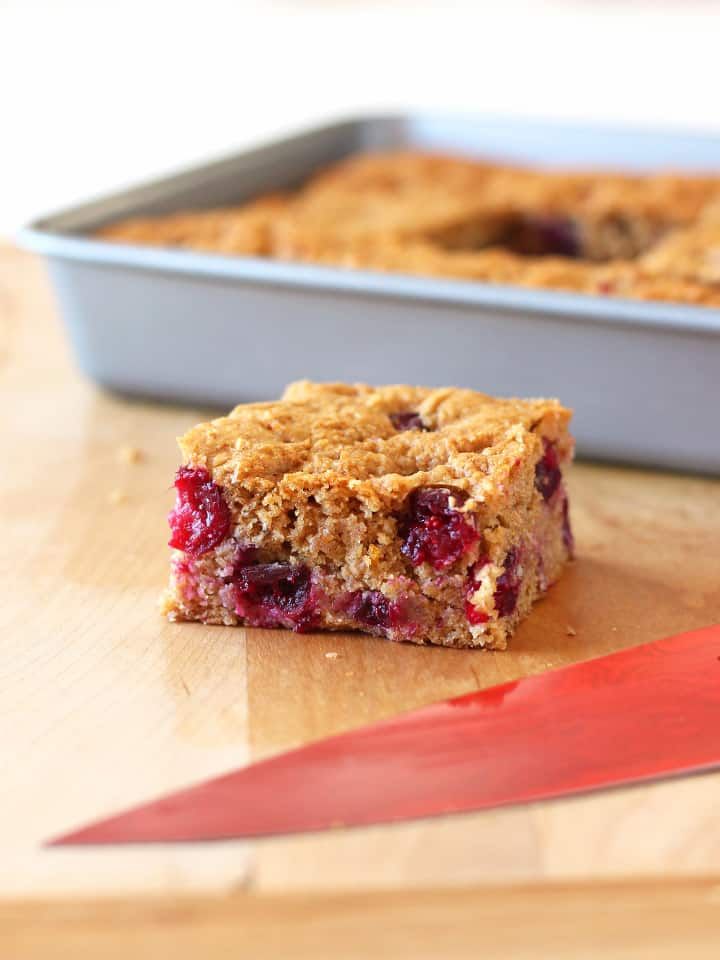 White Chocolate Cranberry Orange Snack Cake. Perfect for your next potluck! A honey sweetened whole grain snack cake studded with tart fresh cranberries and bright orange flavor.