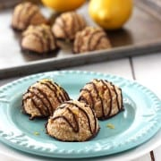 Chocolate Dipped Lemon Macaroons. Add a little zest to your holiday cookie box with these lemony vegan macaroons. Egg-free and made with whole wheat flour, almond meal and naturally sweetened with maple syrup. The bright lemon flavor pairs perfectly with the sweet coconut and chocolate.