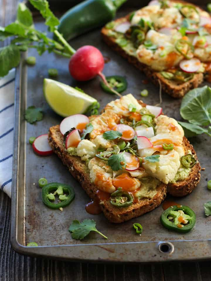 Spicy Avocado Cauliflower Toasts. Toasted whole grain bread, creamy avocado and jalapeno roasted cauliflower. Try one of these veggie topped spicy toasts for your next lunch!