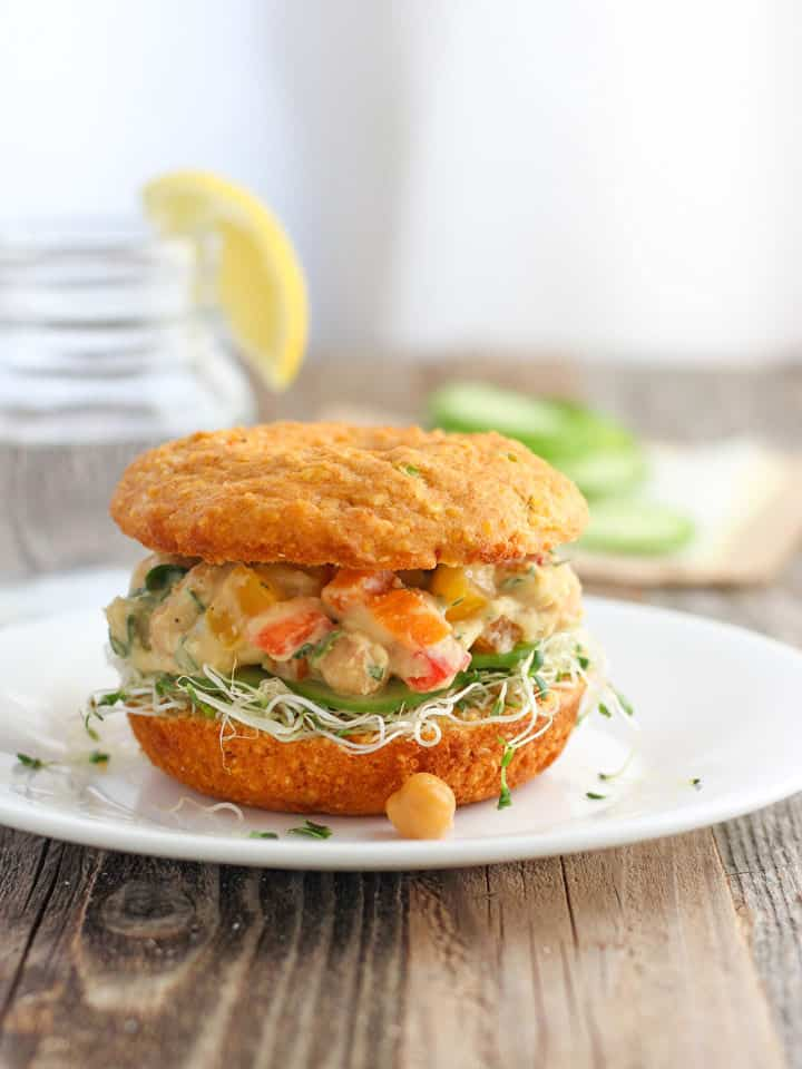 Cornbread Veggie Sandwich. Treat yourself to a tasty lunch of creamy hummus, chickpeas and lots of crisp fresh veggies sandwiched in a savory Cheddar Sriracha Cornbread Donut!