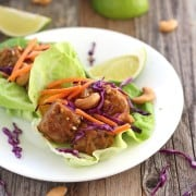 Sriracha Tempeh Lettuce Wraps. Butter lettuce cups filled with baked tempeh, onions and peppers topped with crispy cabbage, carrots and cashews. Enjoy this fresh and easy vegetarian dinner tonight!