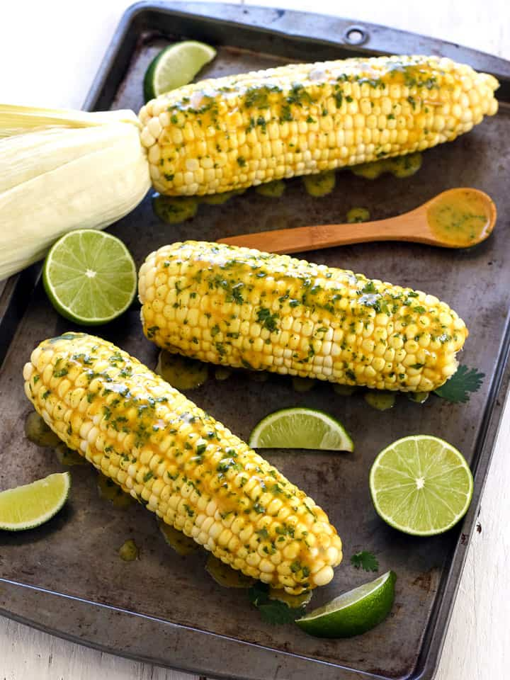 Toaster Oven Baked Corn On The Cob takes only 35 minutes in your little oven. Serve it smothered in creamy curry coconut butter for a fun twist on this classic side dish.