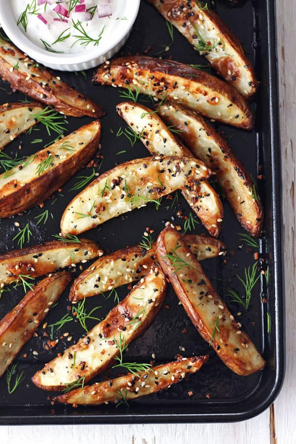 Toaster oven baked potato wedges are crispy outside, creamy inside and way better than takeout. Toss with everything bagel seasoning for the ultimate appetizer or midnight snack.