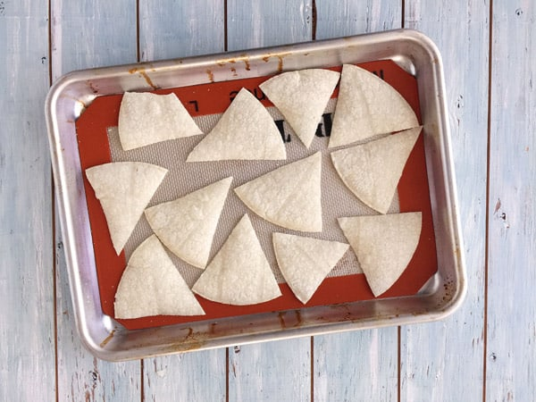 Corn tortilla wedges on a toaster oven baking sheet.