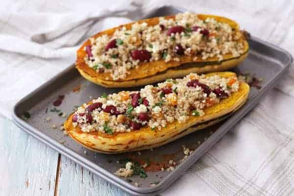Filled delicata squash boats on a toaster oven baking sheet