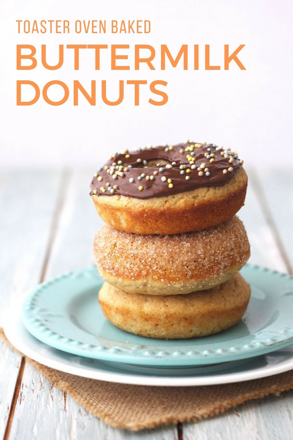 Baked buttermilk donuts stacked on a blue plate.