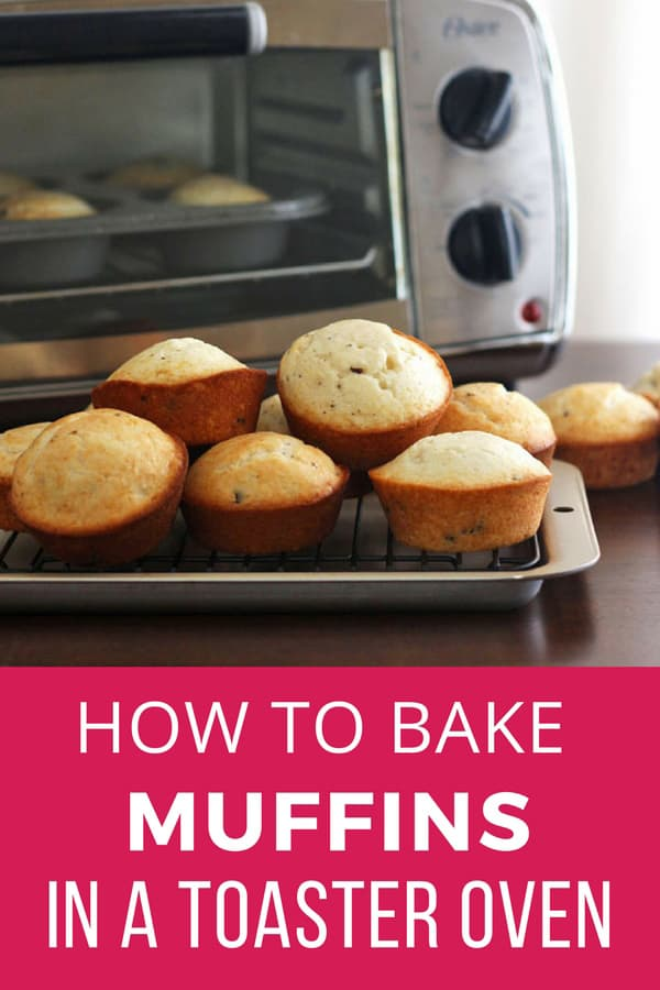 Muffins cooling on a pan in front of a toaster oven.