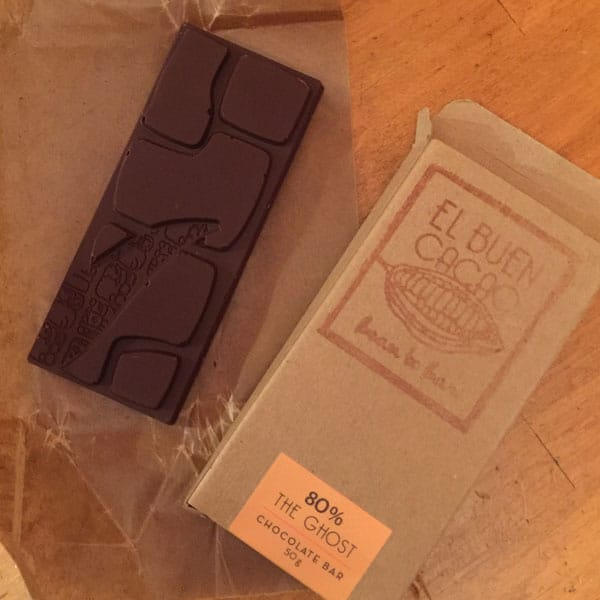 Chocolate Ghost Bar next to packaging on a table.