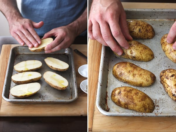 Potato halves rubbed with oil and placed on a baking sheet.