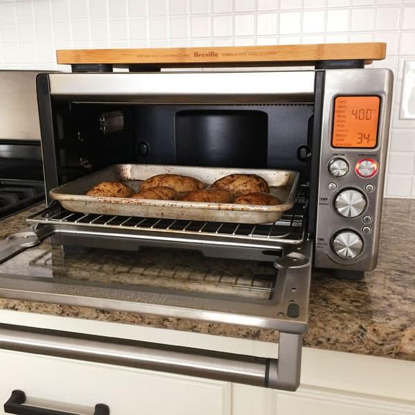 Potatoes on a quarter sheet pan inside a Breville Smart Oven Pro.