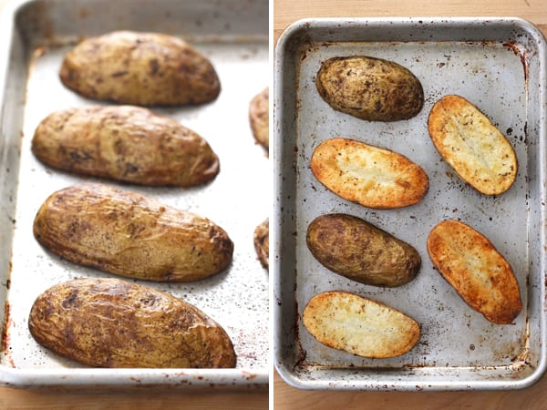 Browned and cooked baked potato halves on a baking sheet.