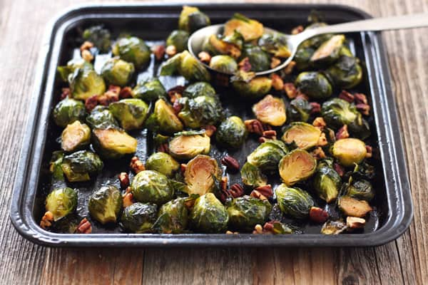 Sriracha and maple syrup adds a new spin on classic roasted Brussels sprouts.