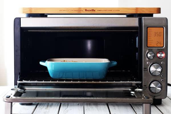A small blue casserole dish inside a Breville Smart Oven Pro.