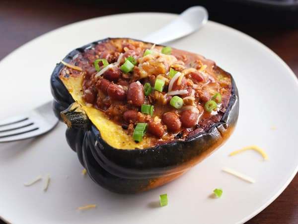 cooked acorn squash bowl filled with chili