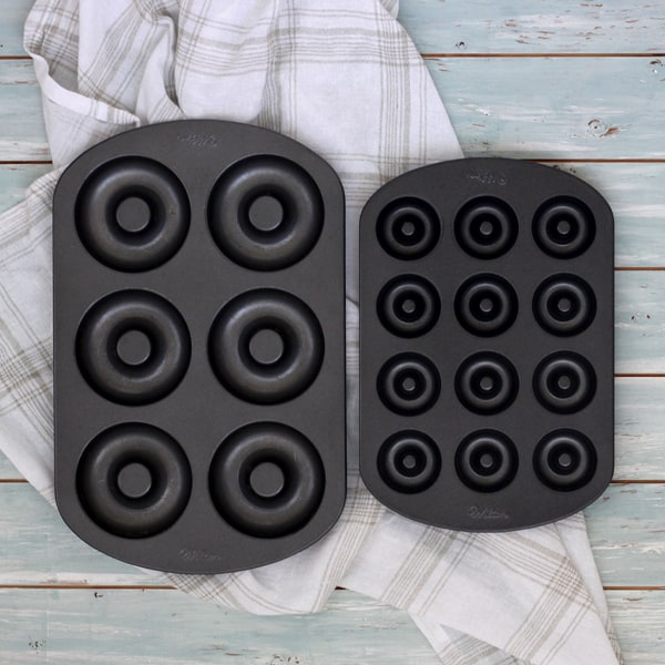 A mini donut pan and a large six-cavity donut pan