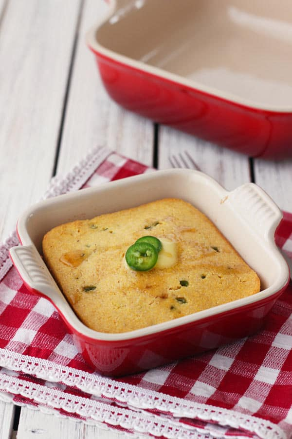 Mini jalapeno cornbread in a red 5 x 5 baking dish