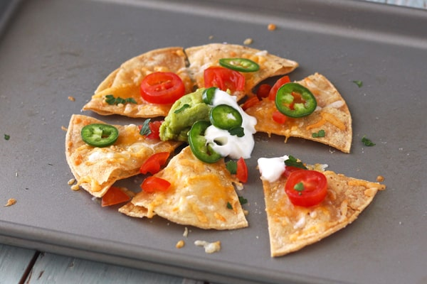Nachos for one with Greek yogurt and jalapeno slices.