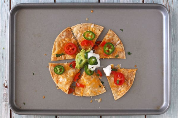 Toaster oven nachos for one one a baking sheet.