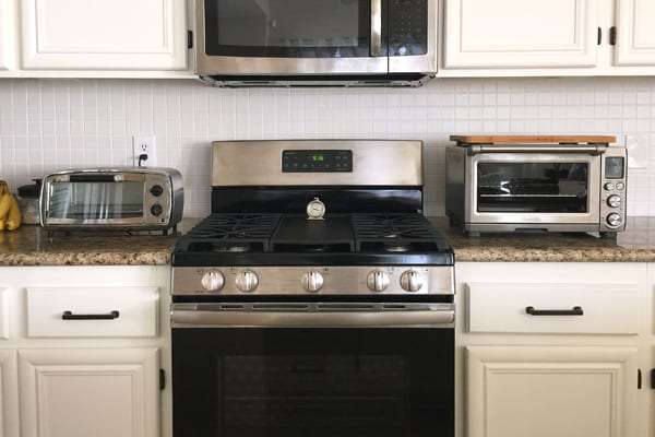 A small Oster toaster oven, large traditional oven and Breville Smart Oven Pro.