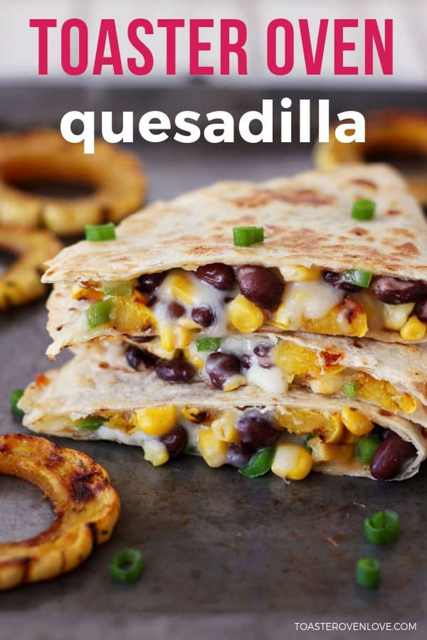 Quesadilla wedges stacked on a baking sheet oozing melted cheese.