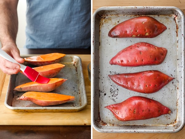 Baked sweet potatoes on a baking sheet brushed with oil.