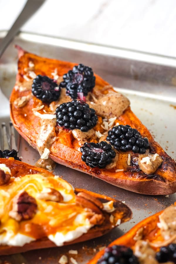 Quick baked sweet potato topped with almond butter and blackberries.