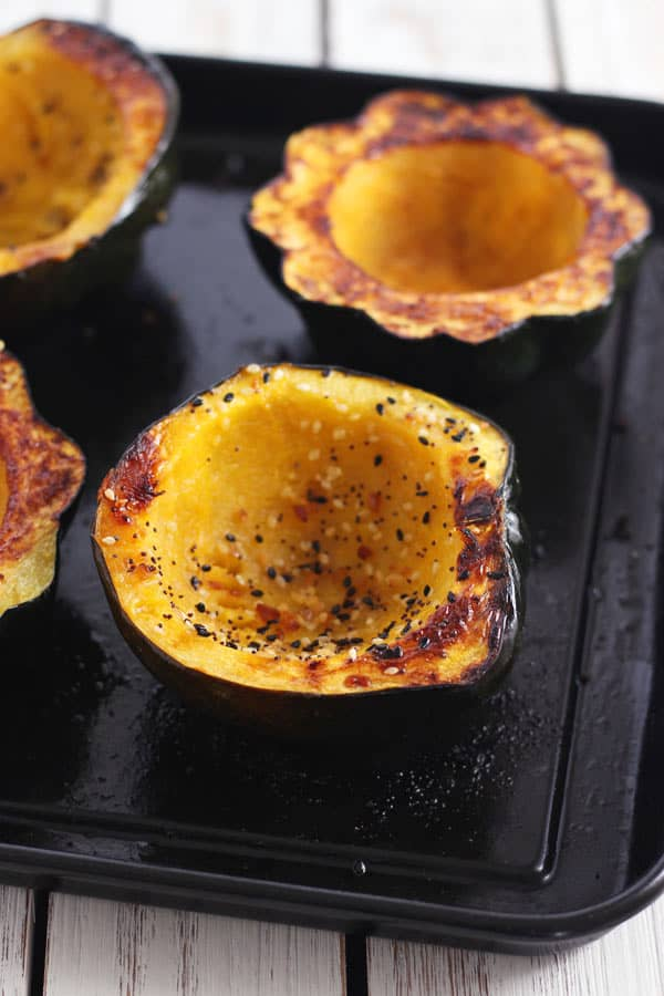 roasted acorn squash bowls on a toaster oven baking pan