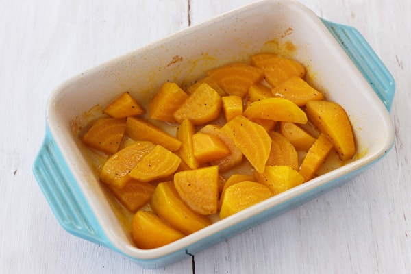Toaster oven roasted golden beets in a small blue baking dish.