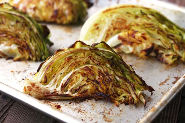 Toaster oven roasted cabbage wedges on a baking sheet.