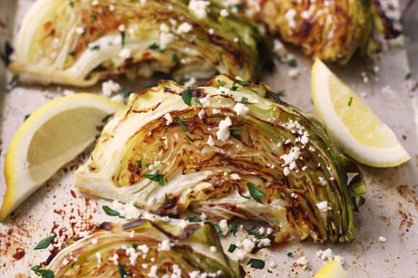 Roasted cabbage wedges with feta and lemon.