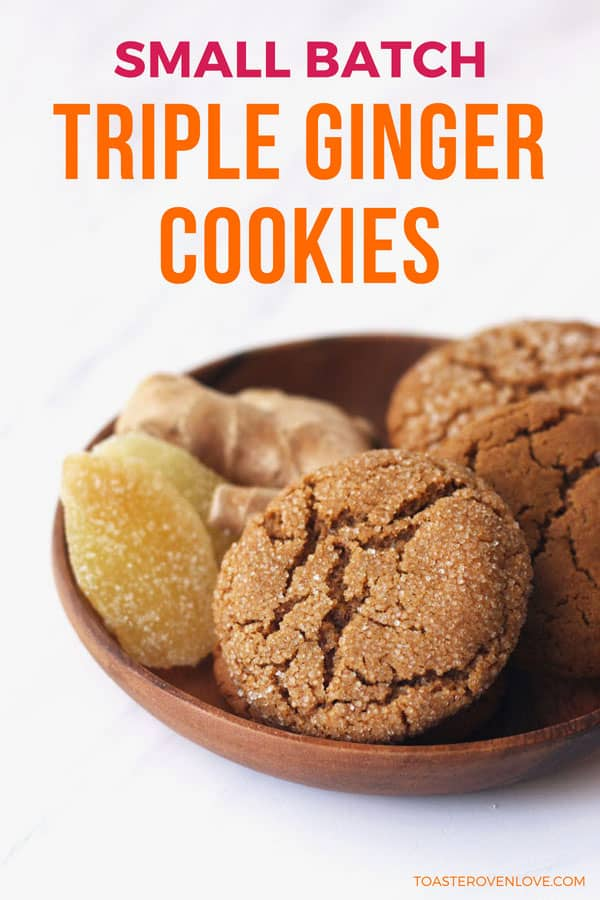 Triple ginger cookies in a wooden bowl with fresh and candied ginger.