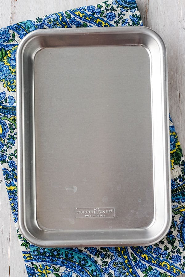 1/8 sheet pan on a blue paisley napkin.